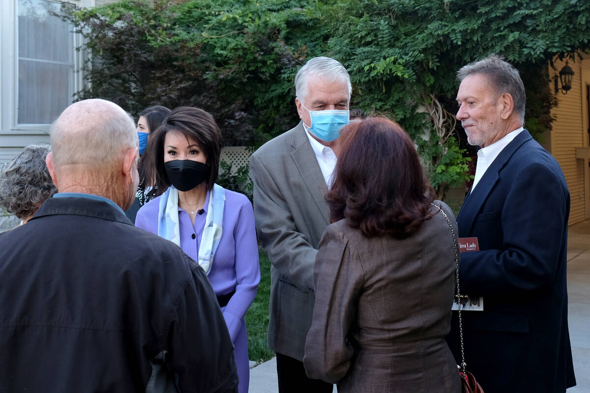 Bill Dentzer/Las Vegas Review-Journal First Lady Kathy Sisolak and Gov. Steve Sisolak speak to ...