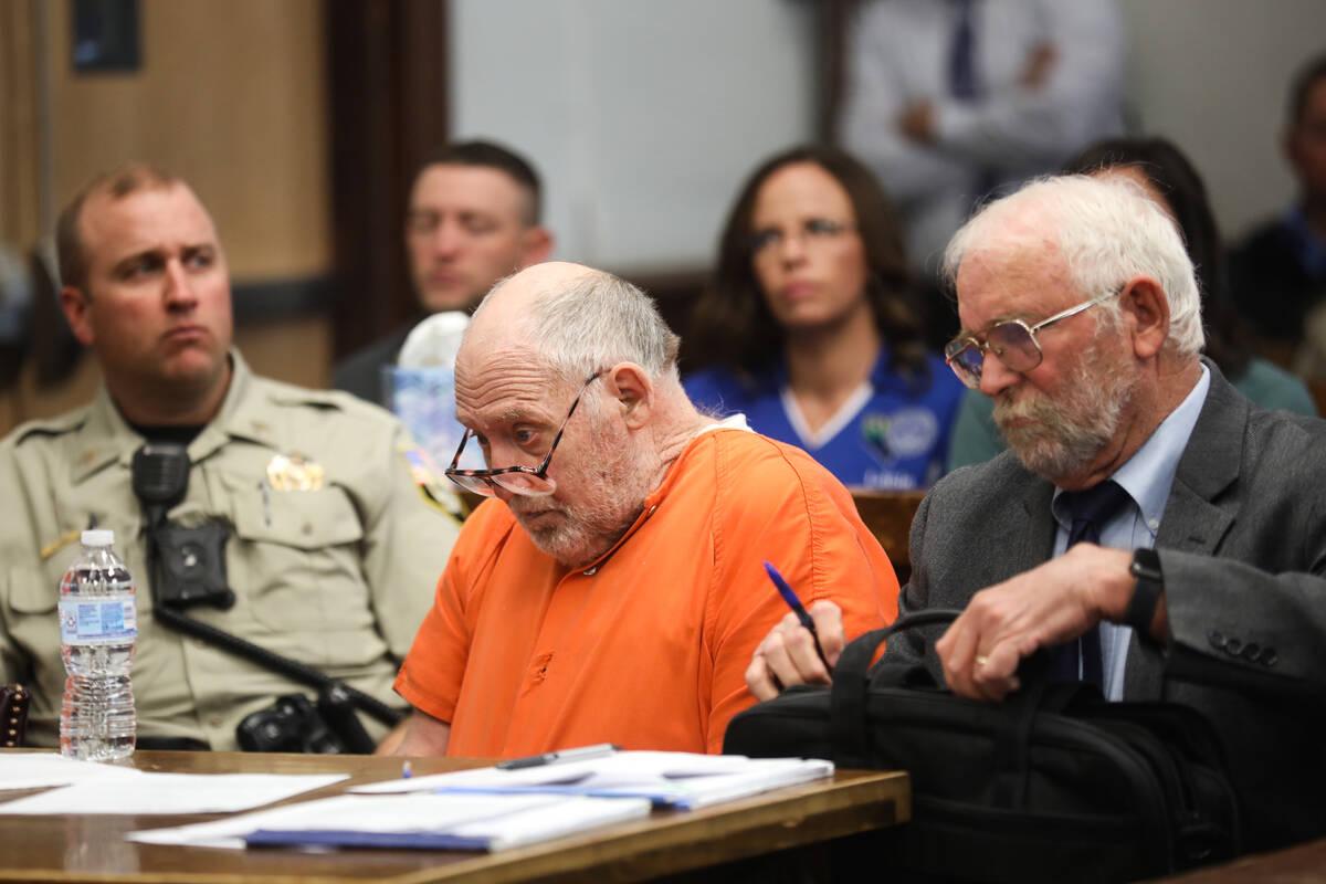 John Dabritz, center, waits during his sentencing hearing next to defense attorney Richard Sear ...