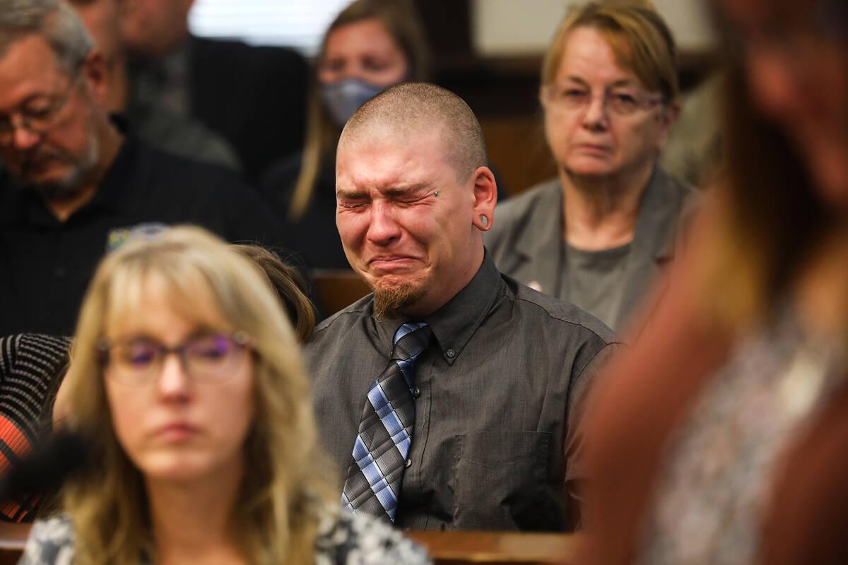 Michael Jenkins, elder son of slain Nevada Highway Patrol Sgt. Ben Jenkins, reacts as his mothe ...