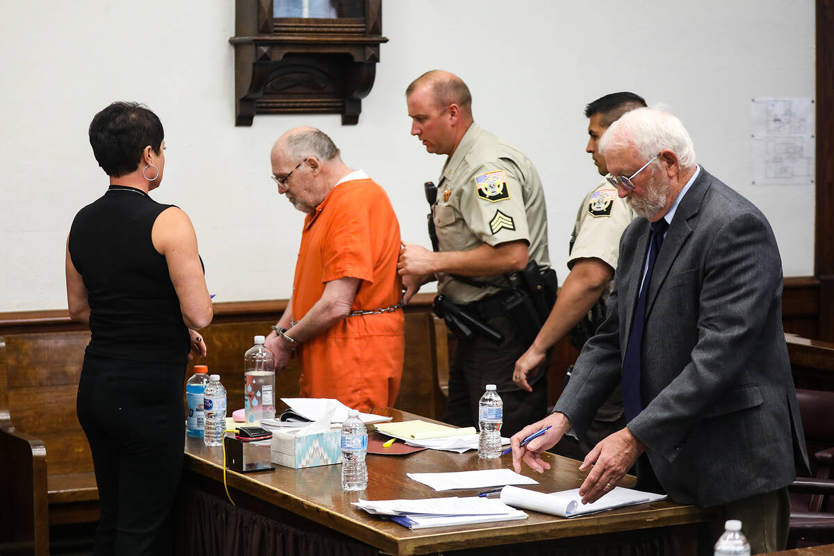 John Dabritz is led out of the courtroom after receiving a sentence of life in prison without t ...