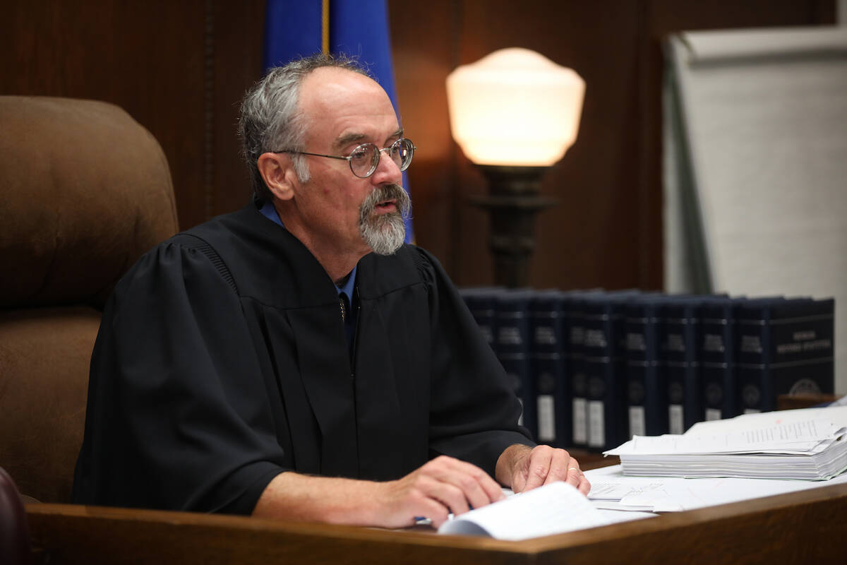 White Pine County District Judge Steve Dobrescu addresses the court during the sentencing of Jo ...
