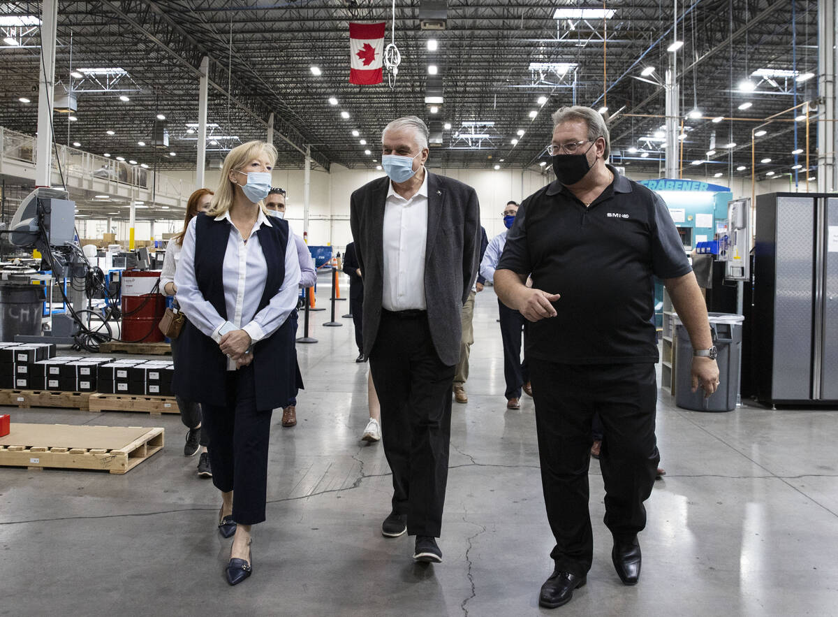 Thomas Power, right, president and CEO of Sunshine Minting Inc., and his wife Patricia Power, v ...