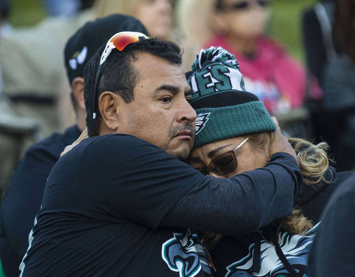 Roberto Ramirez comforts his wife Maria as they attend the annual 1 October Remembrance Ceremon ...