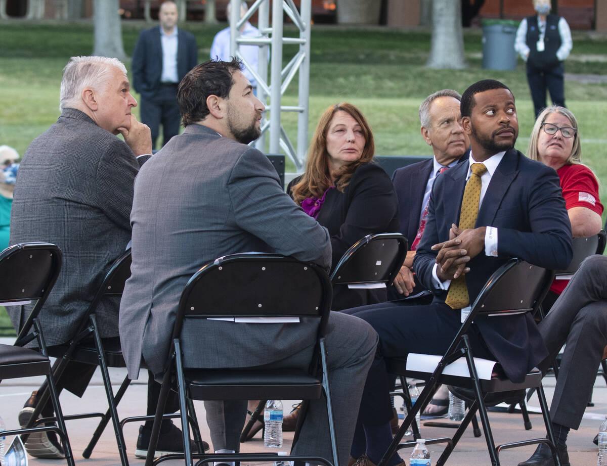 Gov. Steve Sisolak, left, Clark County Commissioners Michael Naft, Marilyn Kirkpatrick, center, ...