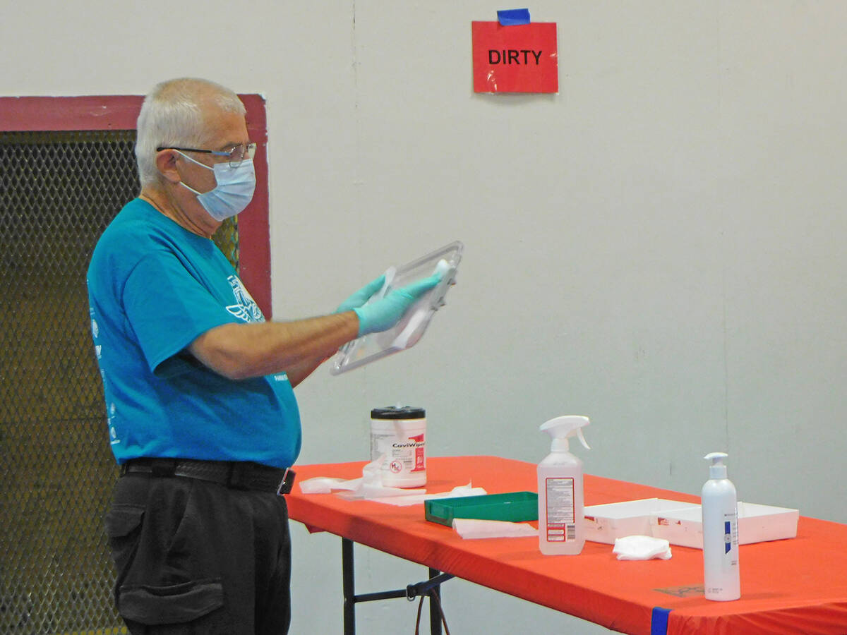 Robin Hebrock/Pahrump Valley Times Sanitization was a high priority for Remote Area Medical cre ...