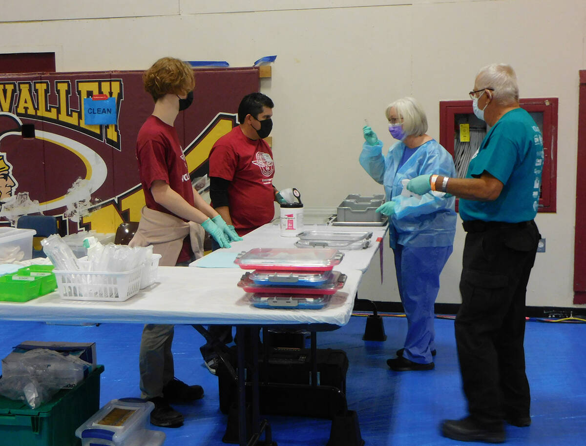 Robin Hebrock/Pahrump Valley Times Remote Area Medical volunteers are pictured discussing the d ...