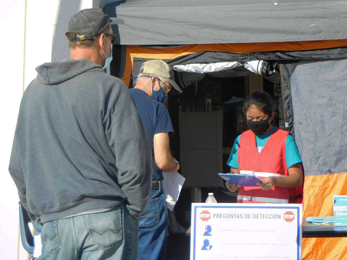 Robin Hebrock/Pahrump Valley Times Patients were notified in batches to proceed to the check-in ...
