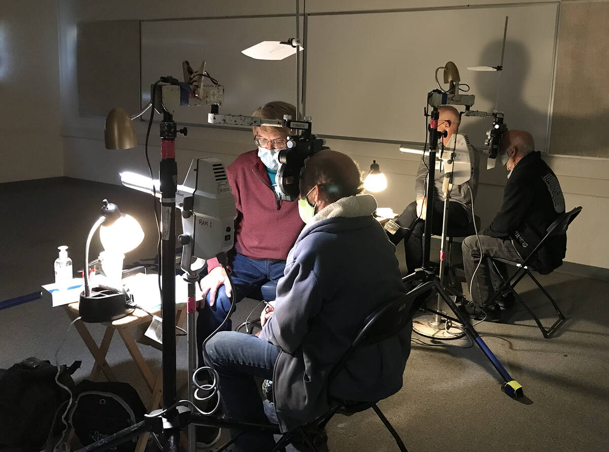 Robin Hebrock/Pahrump Valley Times Two patients are seen having their eyesight examined at the ...
