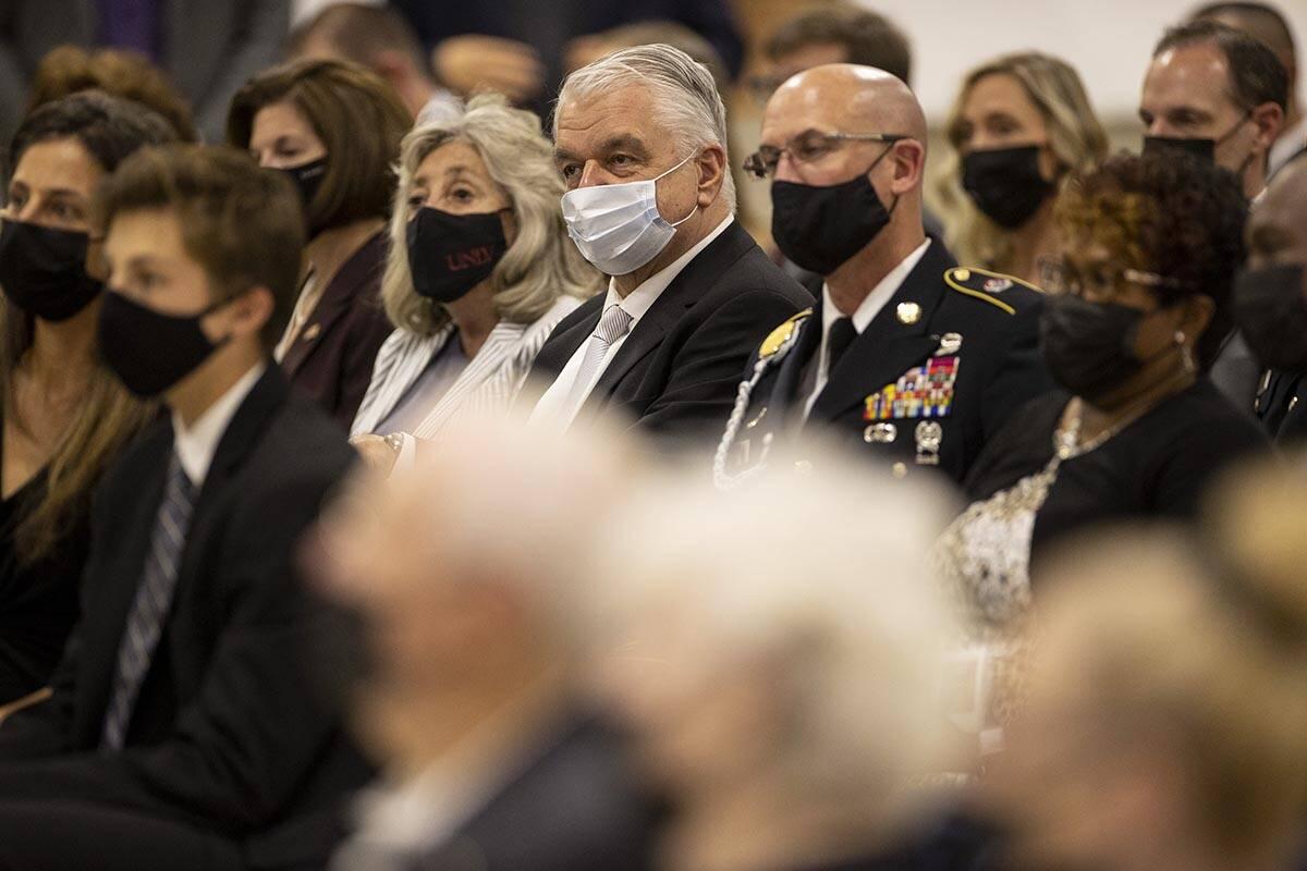 Gov. Steve Sisolak, center, Rep. Dina Titus, left, attend a ceremony to honor the memory of Nev ...