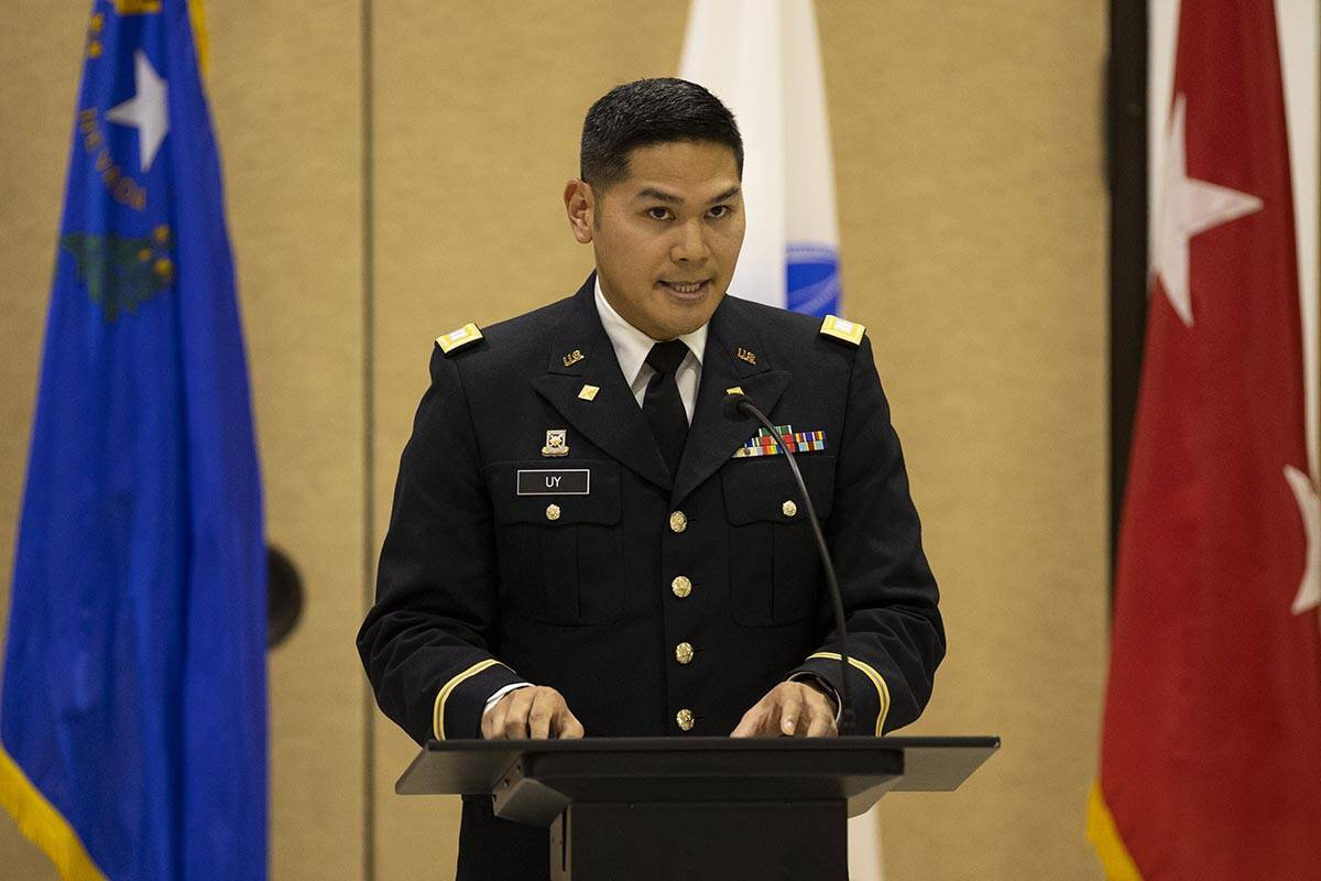 Army National Guard Capt. Gabriel Uy reads a letter on behalf of President Joe Biden during a c ...