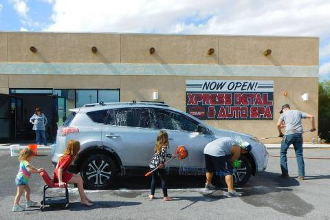 Robin Hebrock/Pahrump Valley Times Volunteers at the Halloween Costumes for Kids Car Wash Donat ...