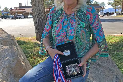 Robin Hebrock/Pahrump Valley Times Debra Strickland is pictured posing with her SASS Nevada Sta ...