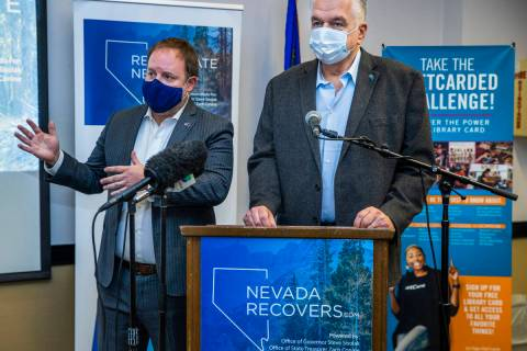 Nevada Treasurer Zach Conine, left, speaks beside Governor Steve Sisolak as they conclude the N ...